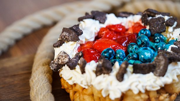 Toy Story Berry Funnel Cake at Stage Door Cafe | From Mike and Sully Popcorn Buckets to Alien Macarons, check out our Guide to Disneyland Pixar Fest Foods and Checklist to keep track of your Disney #PixarFest Foodie Finds! #Disneyland #PixarDisneyParks
