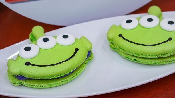 Toy Story Alien Macaron at Alien Pizza Planet | From Mike and Sully Popcorn Buckets to Alien Macarons, check out our Guide to Disneyland Pixar Fest Foods and Checklist to keep track of your Disney #PixarFest Foodie Finds! #Disneyland #PixarDisneyParks